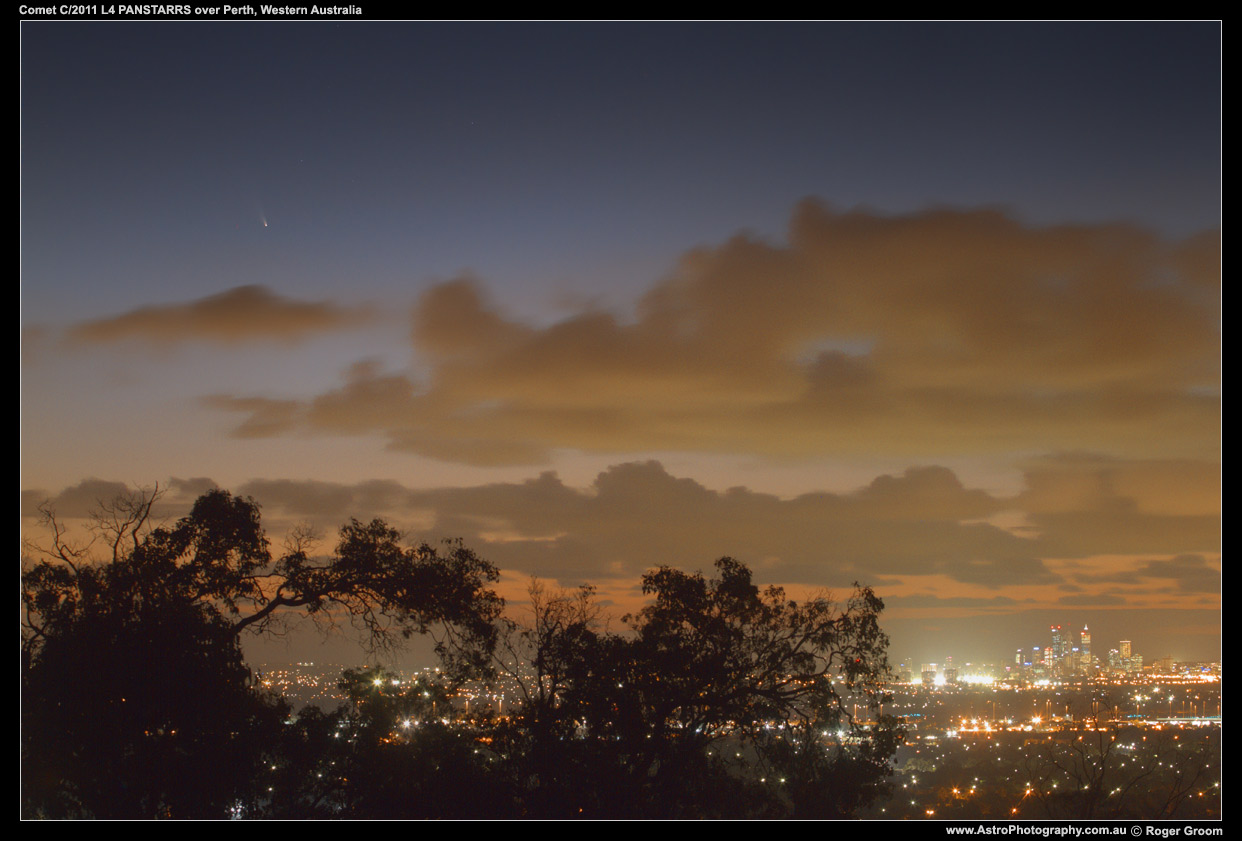 Photograph of Comet C/2011 L4 PANSTARRS over the Perth City Lights