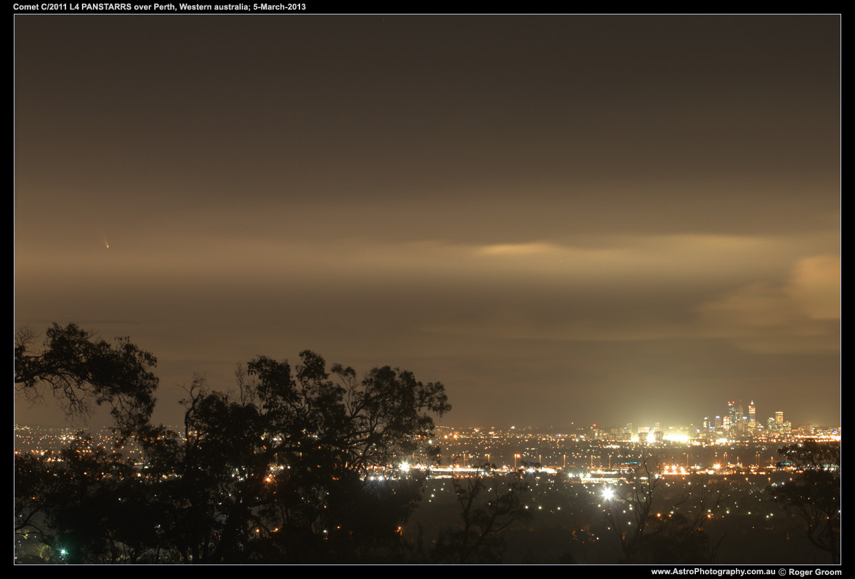 Photograph of Comet C/2011 L4 PANSTARRS over the Perth City