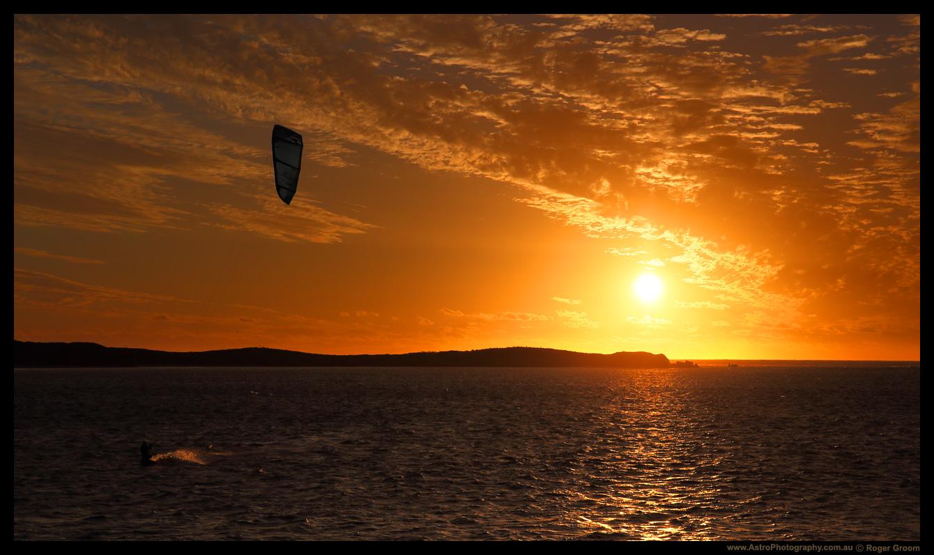 Kitesurfing in a Golden Sunset.