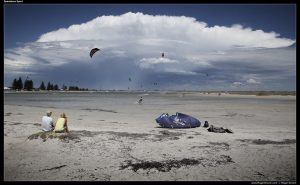 Spectator Sport - The Pond at Safety Bay, with storm clouds in the distance and kite surfers.