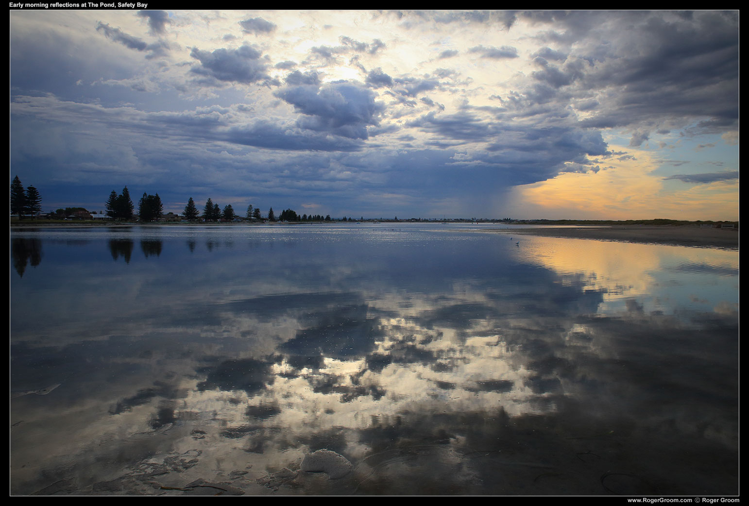 Early morning reflections in The Pond at Safety Bay / Tern Island with storm clouds in the distance.
